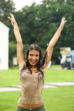 Young happy woman walking in the rain Royalty Free Stock Photography