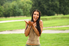 Young happy woman walking in the rain Royalty Free Stock Photos