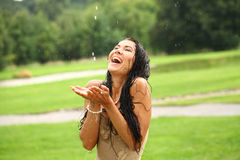 Young happy woman walking in the rain Stock Photo