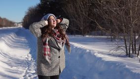 Young happy woman walking in the winter street. stock footage