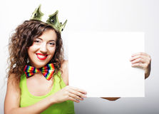 Young happy  woman  wearing crown holding blank sign. Over white background Royalty Free Stock Photos