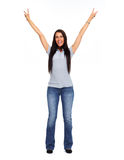 Young happy woman wearing jeans and Tshirt. Royalty Free Stock Images