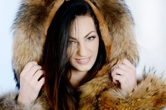 Young happy woman wearing luxurious fur jacket stock images