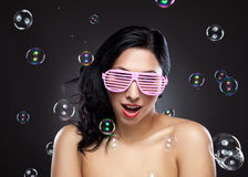 Young and happy woman wearing pink glasses Stock Image
