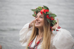 Young happy woman wearing tradisional closes and wreath Royalty Free Stock Image