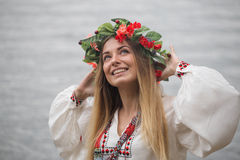 Young happy woman wearing tradisional closes and wreath Royalty Free Stock Photos