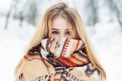 Young happy woman wearing winter cloth. Scarf on the face Royalty Free Stock Photo