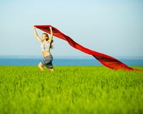 Young happy woman in wheat field with fabric Royalty Free Stock Photos