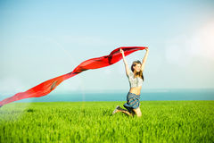Young happy woman in wheat field with fabric Royalty Free Stock Photography