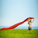 Young happy woman in wheat field with fabric Royalty Free Stock Images