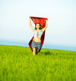 Young happy woman in wheat field with fabric. Summer lifestyle Royalty Free Stock Photos