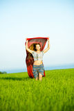 Young happy woman in wheat field with fabric. Summer lifestyle Stock Photography