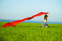 Young happy woman in wheat field with fabric. Summer lifestyle Stock Photos