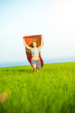 Young happy woman in wheat field with fabric. Summer lifestyle Royalty Free Stock Image