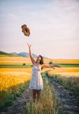 Young happy woman in a wheat field with white dress Royalty Free Stock Photo