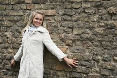 Young Happy Woman In White Fur Coat Royalty Free Stock Image