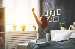 Young   woman woke up in the morning in the bedroom by the windo Royalty Free Stock Image