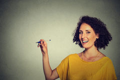 Young happy woman writing on board with empty blank copy space Royalty Free Stock Image