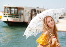 Young happy woman in yellow dress holding umbrella Stock Photography