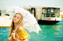Young happy woman in yellow dress holding umbrella Royalty Free Stock Photo