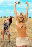 Young happy women. Two young happy women in the field royalty free stock images