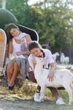 Young happy women with cat and goat on farm Stock Photos