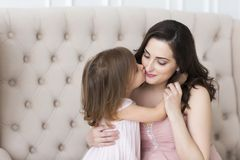 Young happy woman embrace with small daughter Royalty Free Stock Images