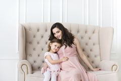 Young happy woman embrace with small daughter Stock Image