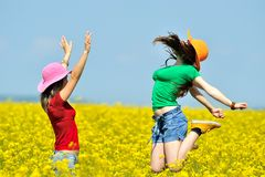 Young happy women on field in summer Royalty Free Stock Image
