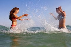 Young happy women having fun in water Stock Photo