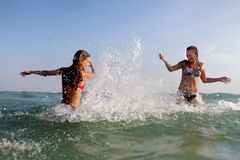 Young happy women having fun in water Stock Photos