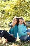 Young happy women on natural autumn background Royalty Free Stock Photos