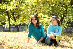 Young happy women on natural autumn background Royalty Free Stock Images