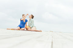 Young happy women on natural background Stock Image