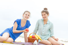 Young happy women on natural background Stock Photos