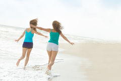 Young happy women on natural background Royalty Free Stock Photography