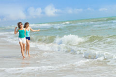 Young happy women on natural background Stock Images