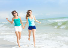 Young happy women on natural background Royalty Free Stock Photos