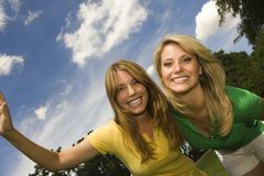 Young happy women in park. Young happy women in the park Royalty Free Stock Images
