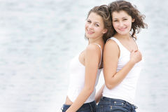 Young happy women on sea background Stock Image