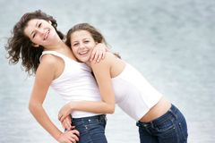Young happy women on sea background Royalty Free Stock Images