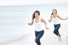 Young happy women on sea background Stock Images