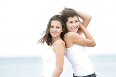 Young happy women on sea background Royalty Free Stock Photo