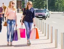 Young happy women with shopping bags Royalty Free Stock Image