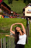 Young happy women stretching. Young happy woman stretching in the morning outside stock photography