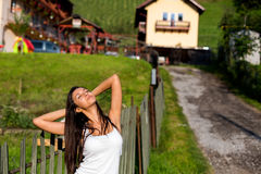 Young happy women stretching. Young happy woman stretching in the morning outside royalty free stock photography