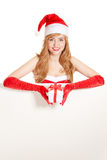 Young happy xmas woman holding gift. Royalty Free Stock Photo
