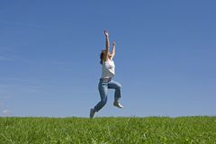Young and happyness women. Young woman is jumping, concept of happiness and zest for life Royalty Free Stock Photography