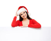 Young and happywoman in a Christmss hat with a banner Stock Image