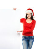 Young and happywoman in a Christmss hat with a banner Royalty Free Stock Photos